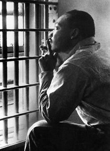 MARTIN LUTHER KING, JR, sitting in the Jefferson County Jail, in Birmingham, Alabama, 11/3/67